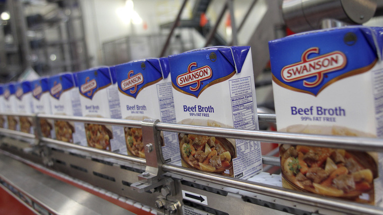 Boxes of beef broth on conveyor belt