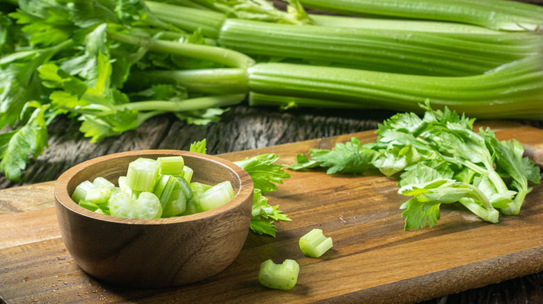 Celery on a brown cutting board