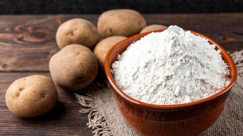 Potatoes and potato starch on a table