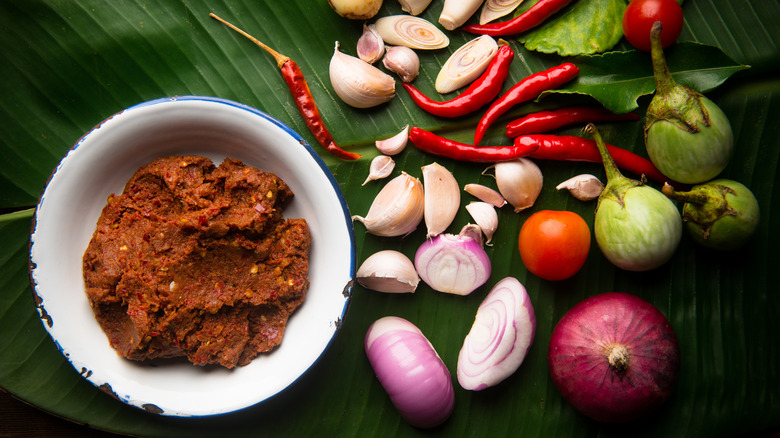 Red curry paste in a white dish