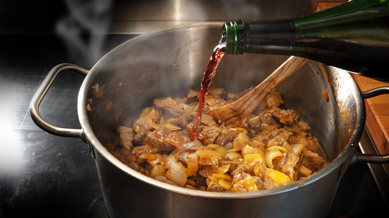 Red wine being poured into a pot