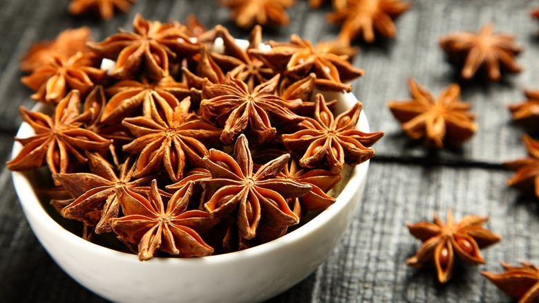 Star anise fruits in a white bowl