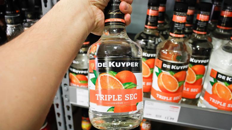 Shelf of triple sec bottles