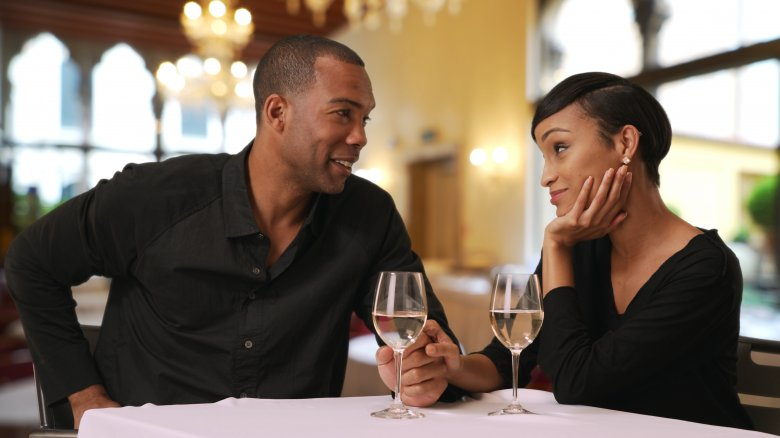 Man and woman eating at nice restaurant