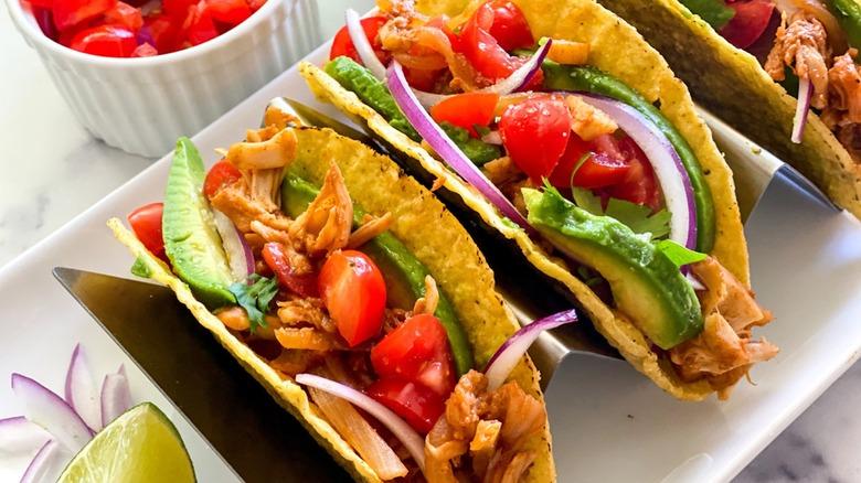 jackfruit tacos with avocado, tomato, cilantro, and lime