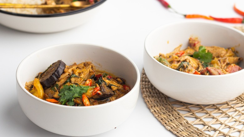 curry served with chicken and vegetables