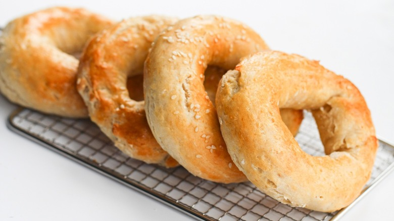 Freshly baked bagels on a serving tray.