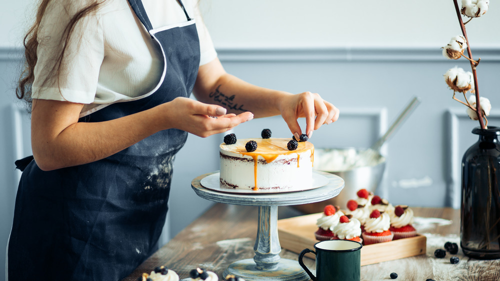 Chef decorating a cake