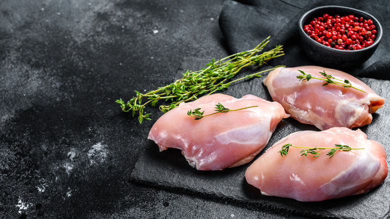 Raw chicken thighs with herbs