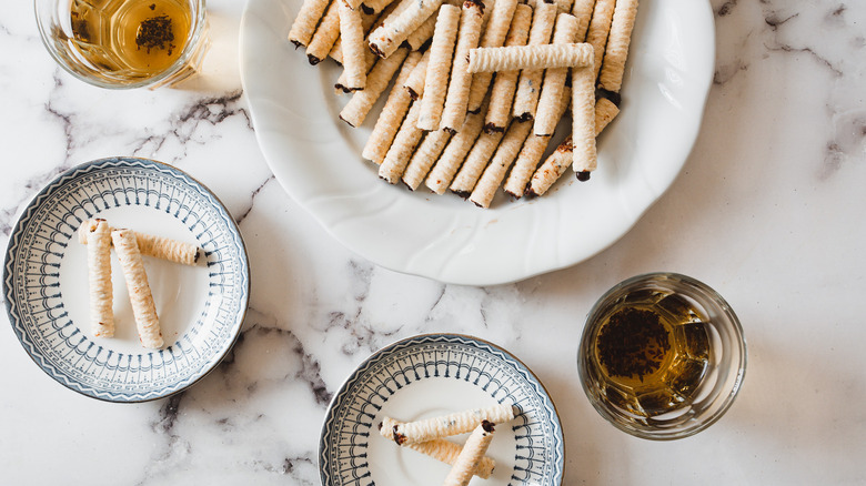 cookies on plates with two tea cups