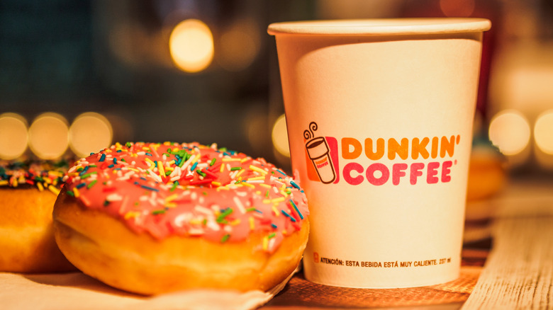 A small Dunkin' coffee with a sprinkle donut