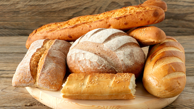 Various loaves of bread on a tray