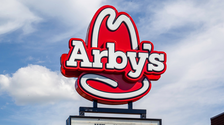 Arby's sign and clouds