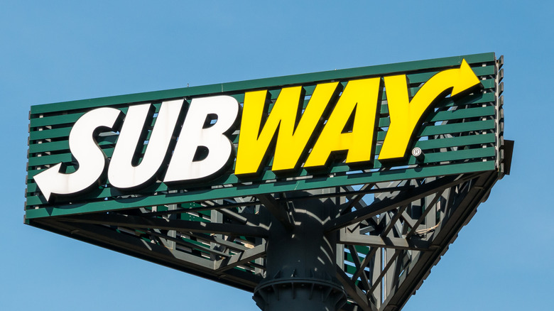 Subway sign with blue sky