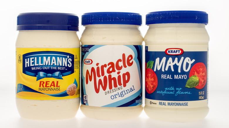 Side-by-side jars of Miracle Whip, Hellmann's Mayo, and Kraft Mayo