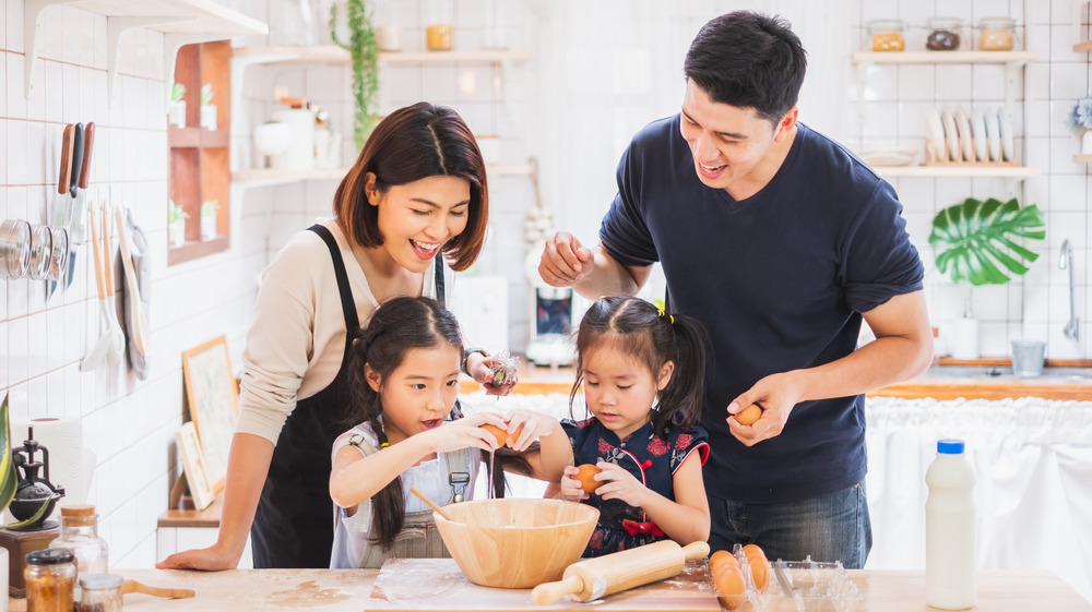 Family cooking a meal together