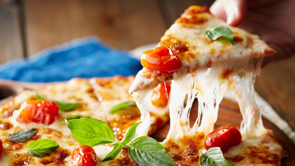 Margherita pizza with tomato, basil, and cheese