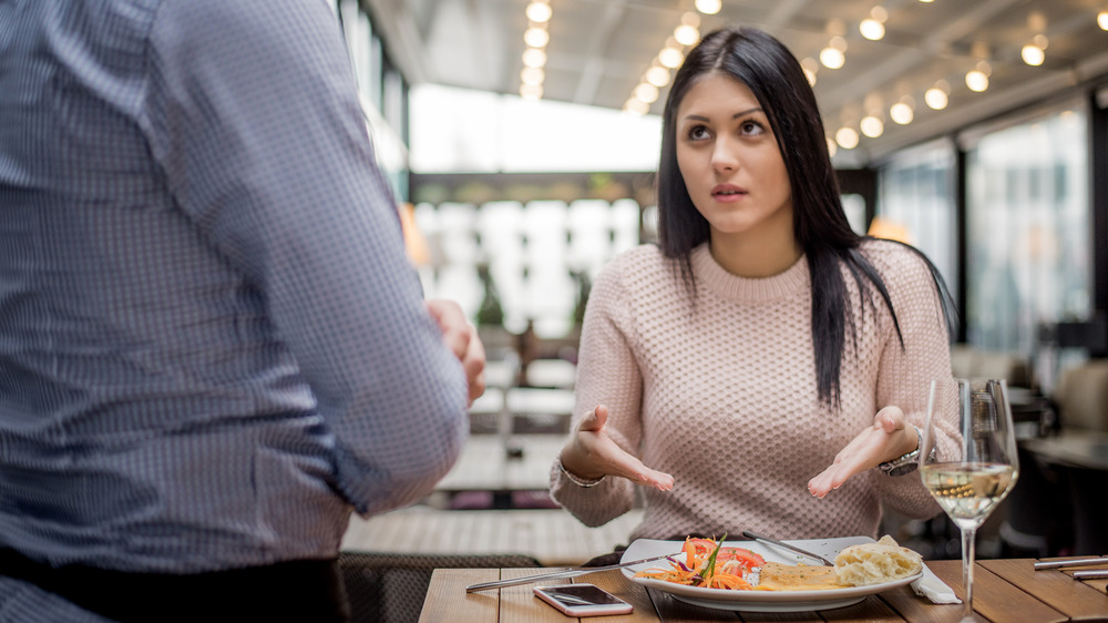 woman sending food back at restaurant