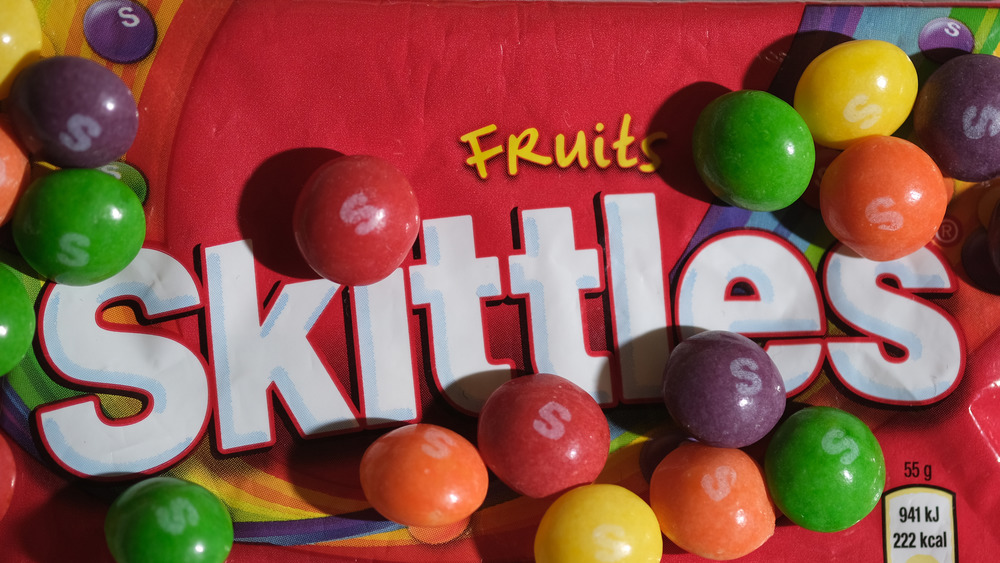 Skittles candy on top of Skittles bag