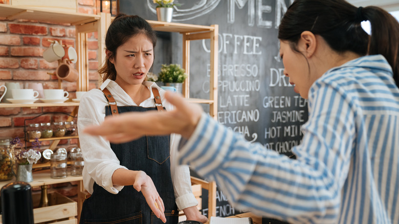 Barista dealing with angry customer