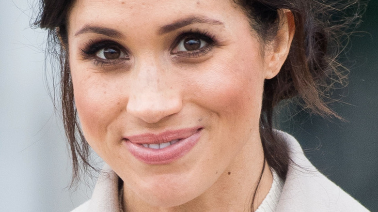 Meghan Markle smiling for photographers