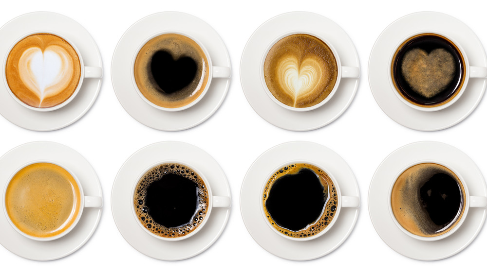 various kinds of coffee drinks in white cups
