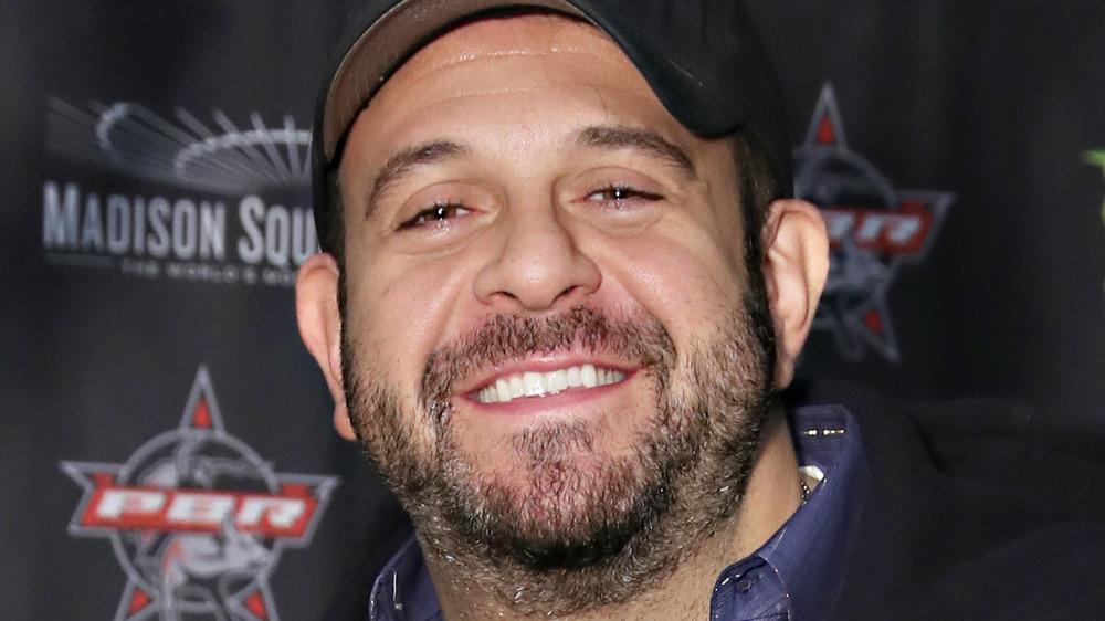 Adam Richman smiling at event