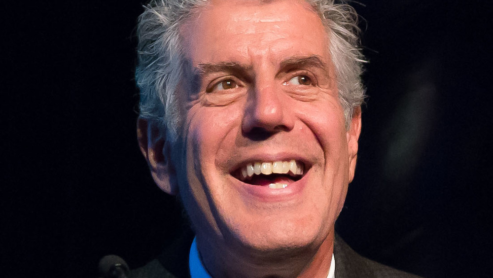Anthony Bourdain smiling on stage