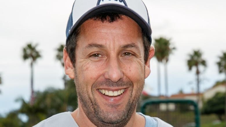 Adam Sandler in baseball cap