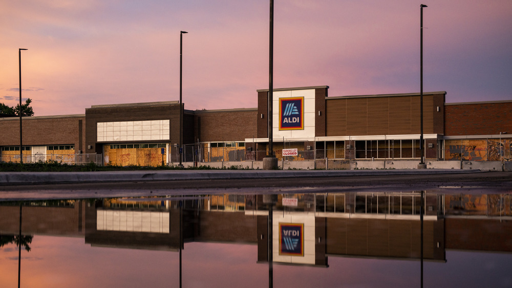 Aldi store exterior water reflection