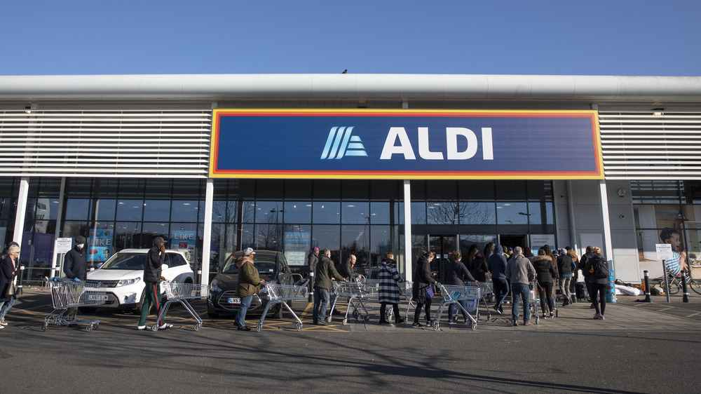 Customers lined up at Aldi supermarket