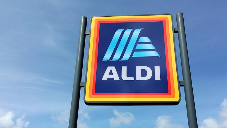 Aldi storefront sign on blue sky background