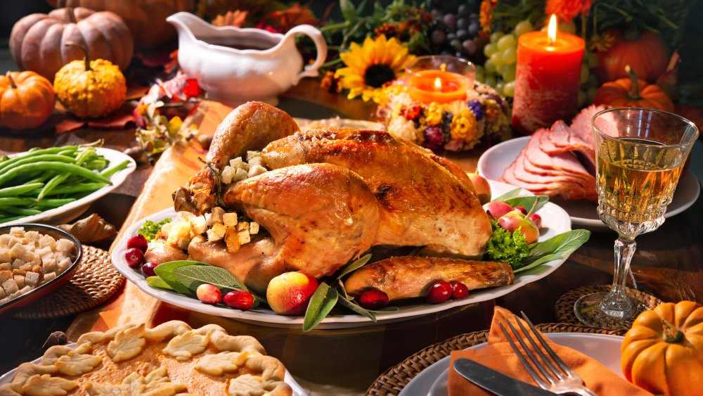 Thanksgiving table with turkey and sides
