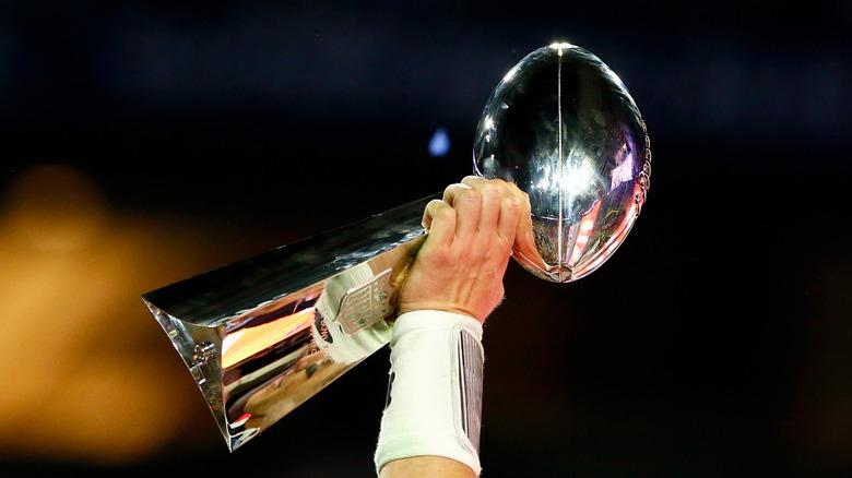 Super Bowl trophy in hand