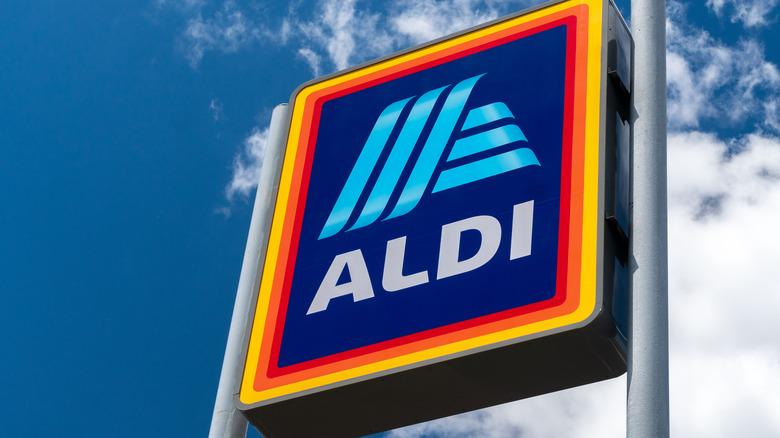 Colorful Aldi logo against blue sky background