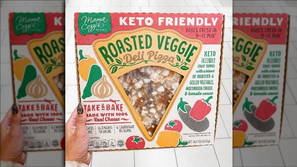 Hand holding new Aldi pizza