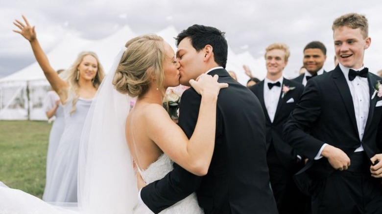 Alex Drummond and husband Mauricio kissing
