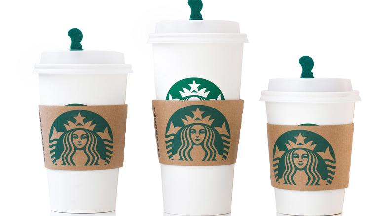 Three cups with Starbucks logo