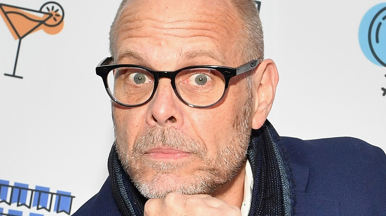 Alton Brown resting fist on his chin