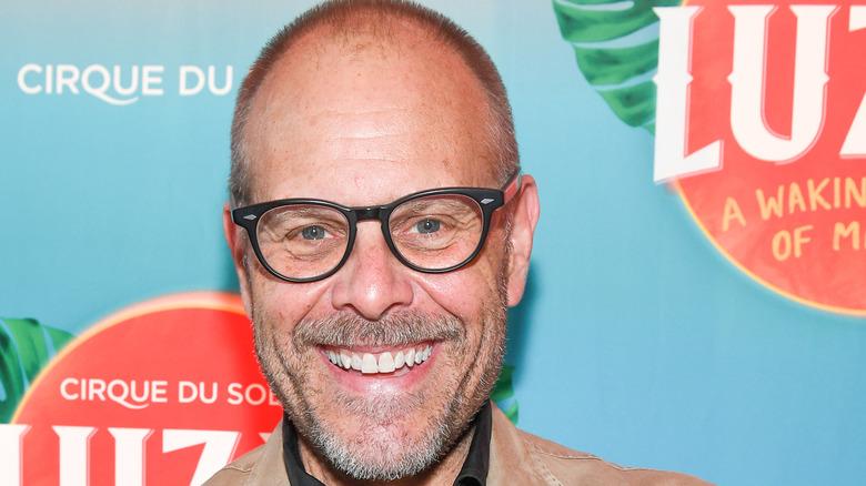 Alton Brown smiling in glasses