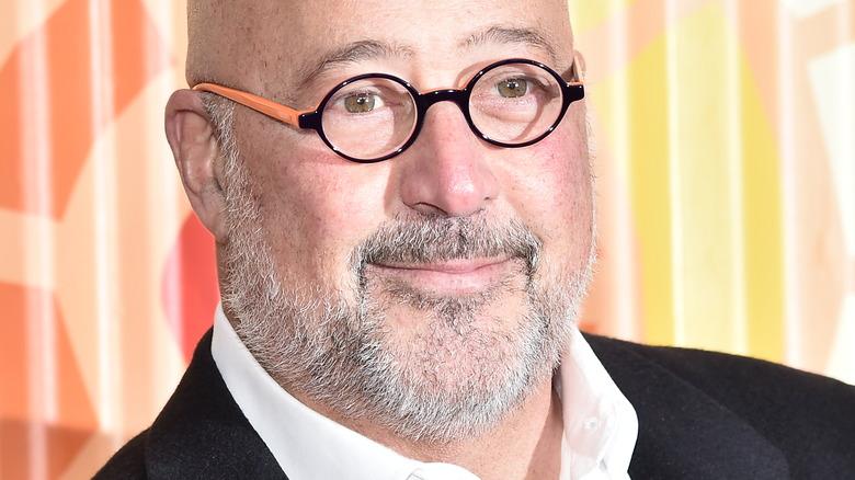 Andrew Zimmern wearing glasses
