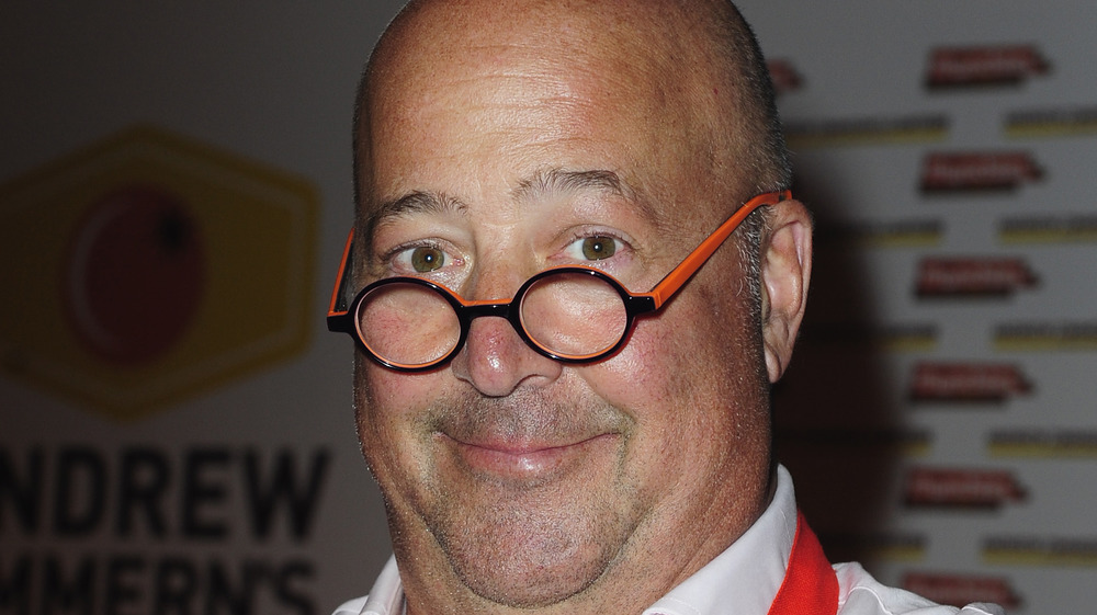 Andrew Zimmern wears signature glasses