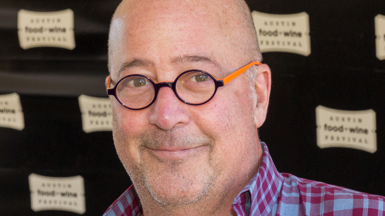 Close up of Andrew Zimmern wearing plaid shirt