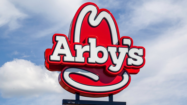 Arby's sign against blue sky