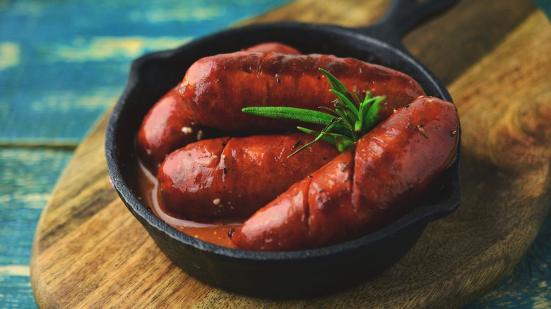 Grilled chorizo in cast iron pan with sauce
