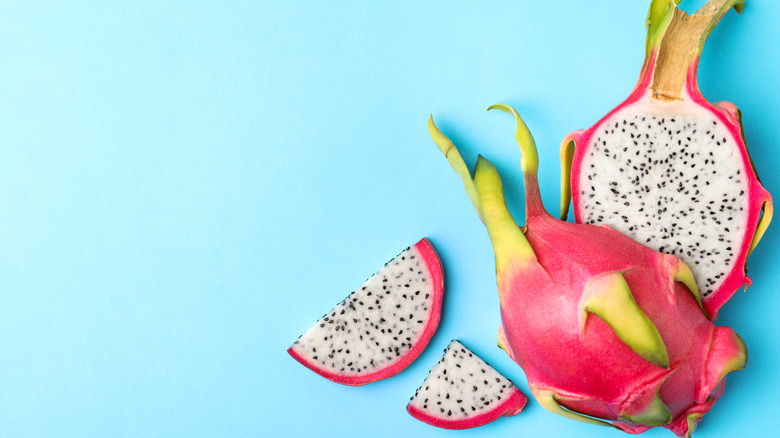 sliced dragon fruit on blue background