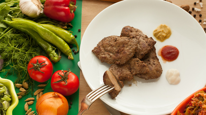 vegetables and a plate of meat