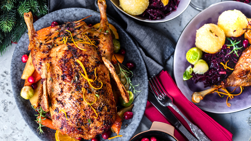 Roasted duck on a festive holiday table