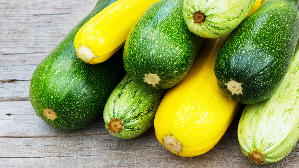 Yellow and green zucchini stacked on each other