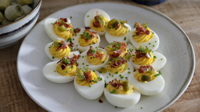Deviled eggs sitting on a plate